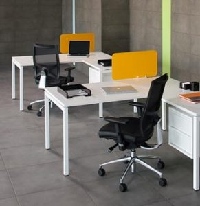 Octopus Forty4 individual desks with L-shaped returns in white with orange perspex screens