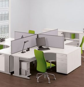 A cluster of 4 crescent shaped cantilever desks with white tops and white desk-height pedestals, metallic legs and light grey worktop divider screens