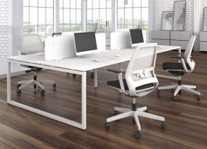 An elegant O frame bench desking system with wite screens