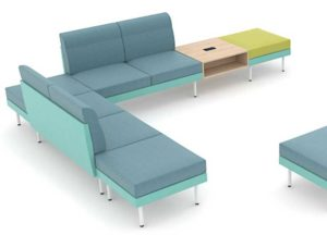 Modular office breakout and soft seating in dual fabric pictured here with a combination of modules with low back and without backs. Also includes an integrated coffee table with in-built power sockets