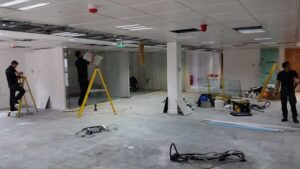 Our tradesmen working on an office fitout